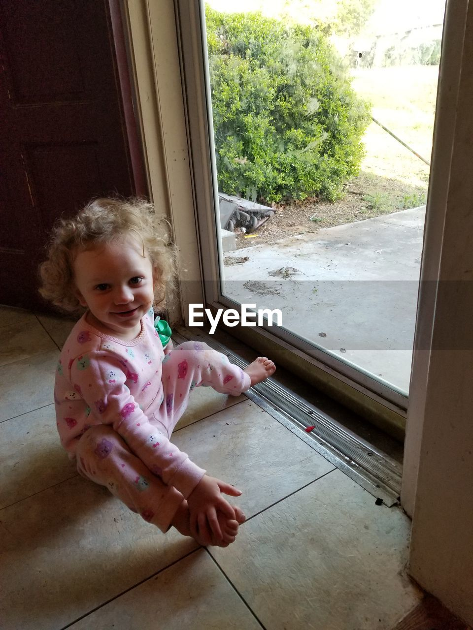 childhood, child, one person, window, indoors, real people, full length, home interior, day, innocence, young, glass - material, baby, toddler, door, entrance, girls, looking, flooring