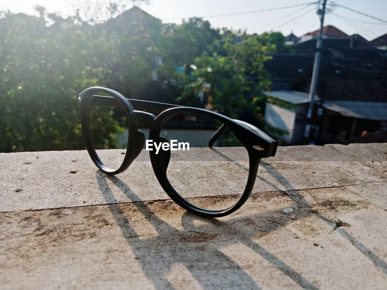 Close-up of eyeglasses on retaining wall