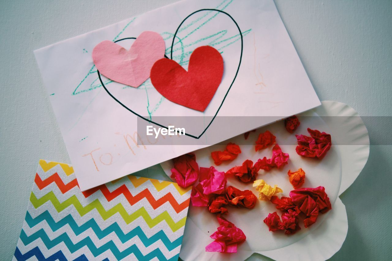 HIGH ANGLE VIEW OF HEART SHAPE MADE OF MULTI COLORED FLOWER