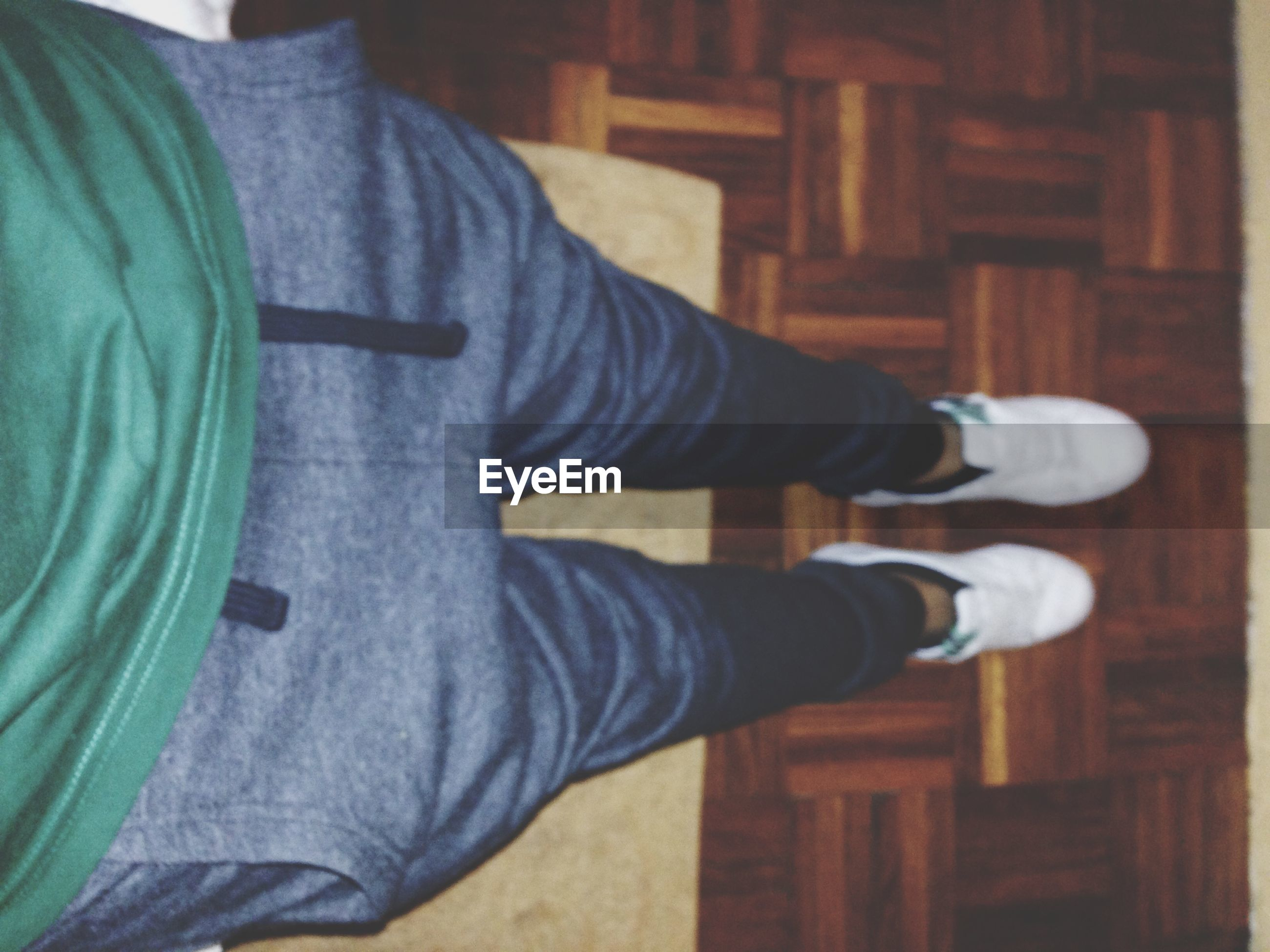 lifestyles, indoors, men, casual clothing, leisure activity, low section, person, jeans, standing, holding, shoe, part of, personal perspective, midsection, rear view, unrecognizable person