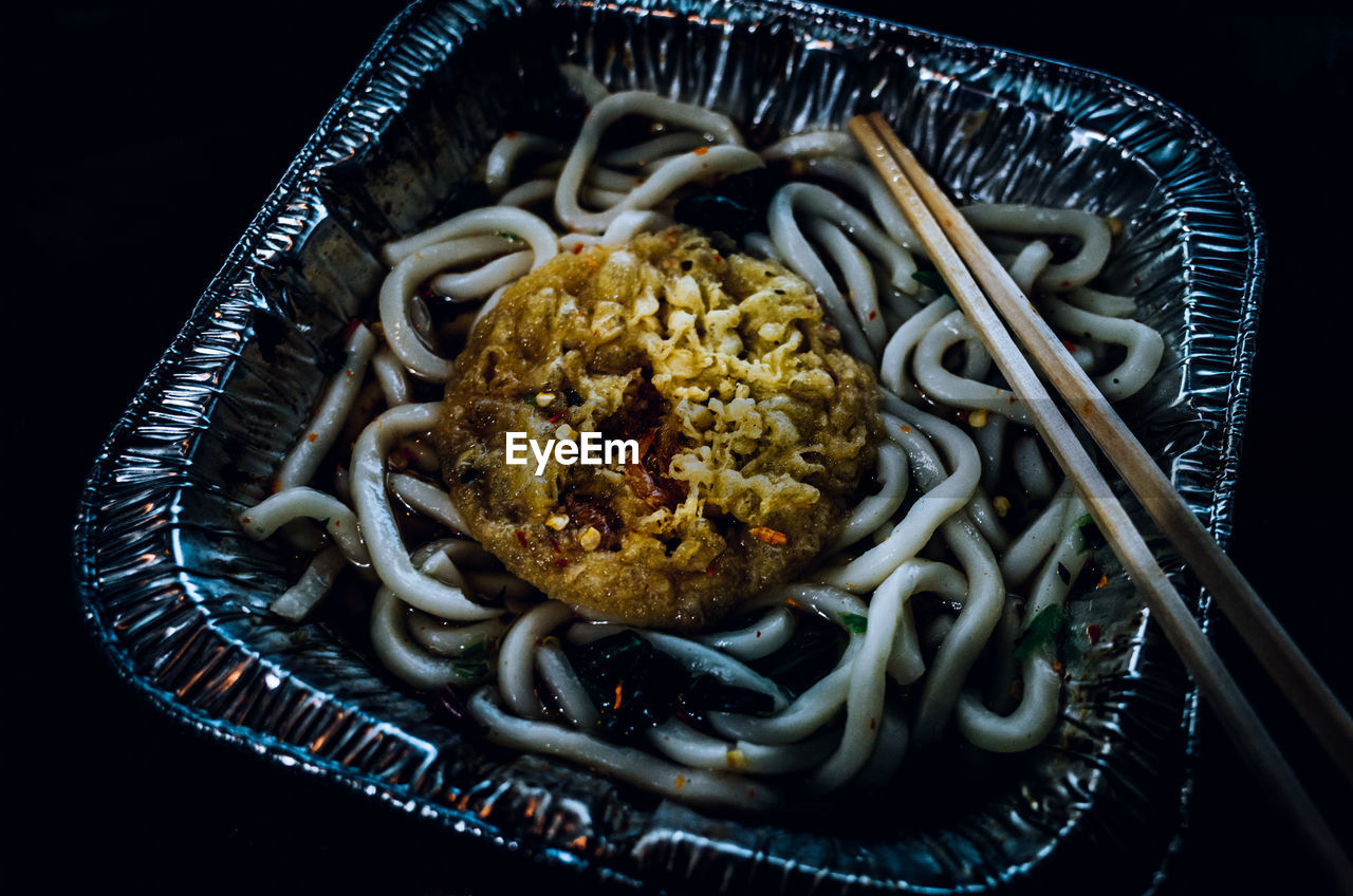 Close-up of noodles served in plate on table
