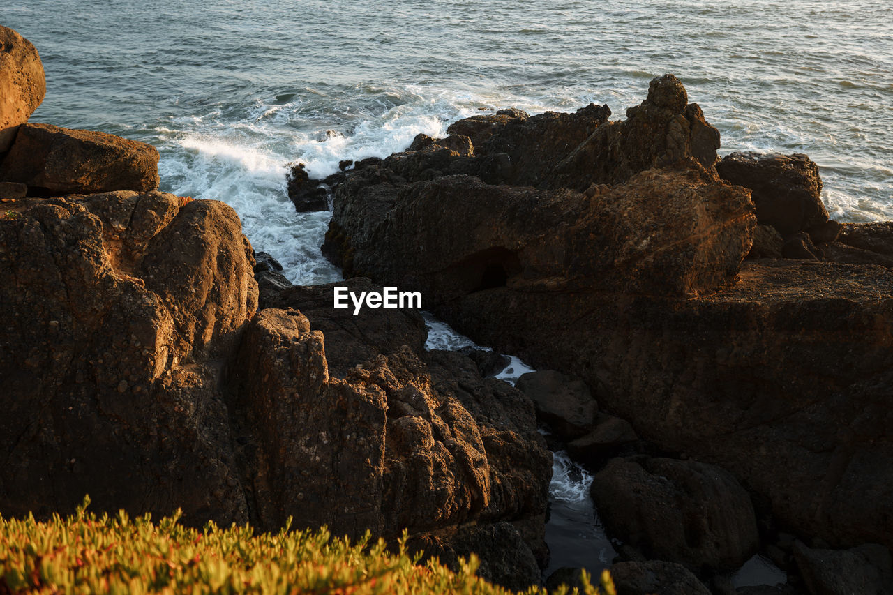 SCENIC VIEW OF ROCKS ON BEACH