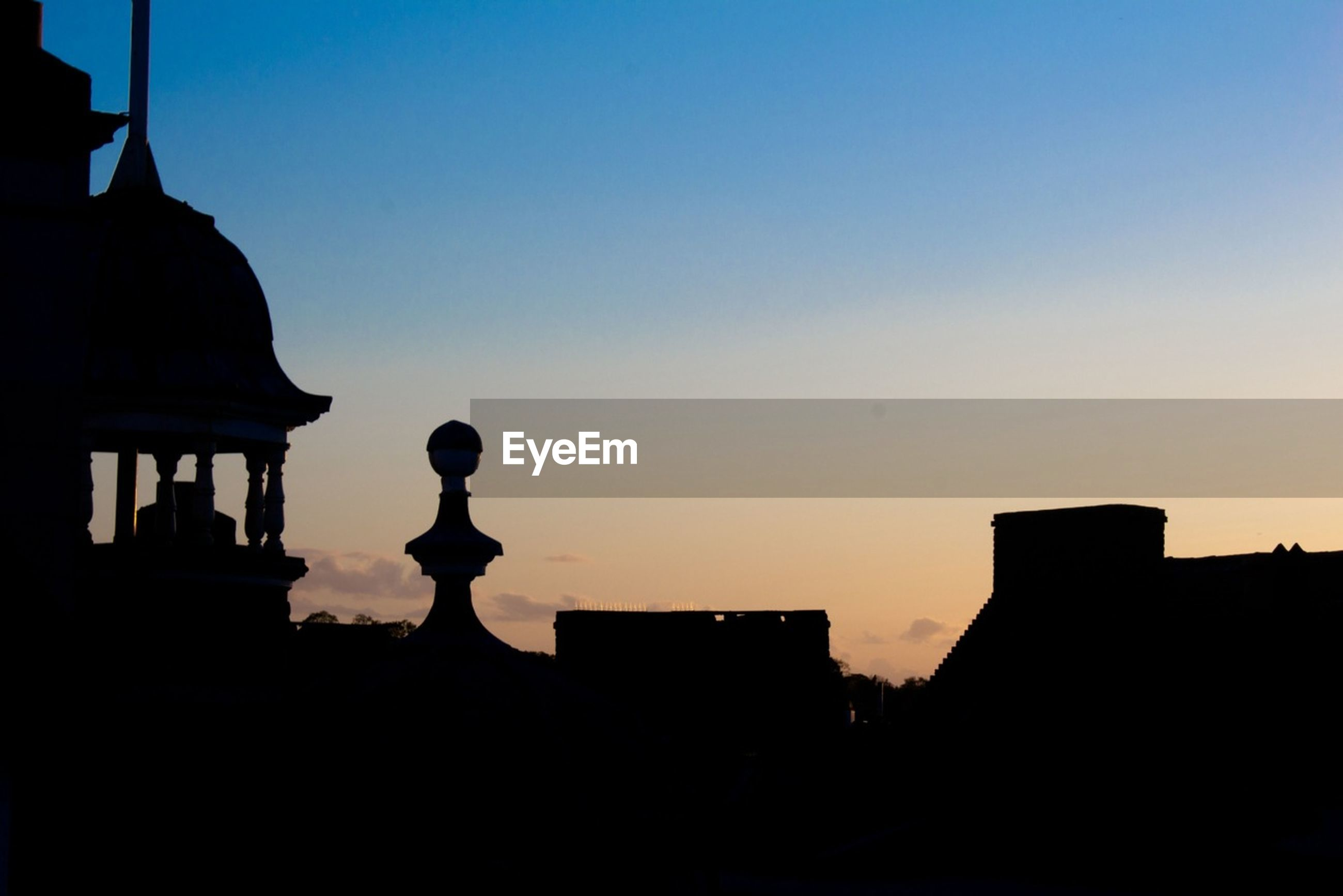silhouette, architecture, building exterior, built structure, clear sky, copy space, sunset, low angle view, building, dusk, sky, residential structure, house, blue, dark, residential building, outline, outdoors, no people, city