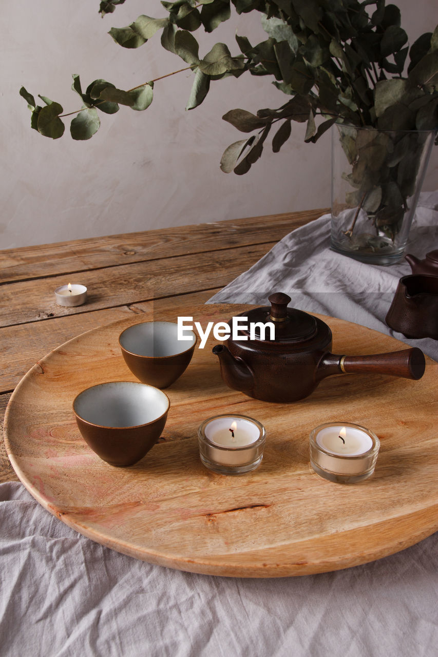 TEA CUP ON TABLE WITH SPOON