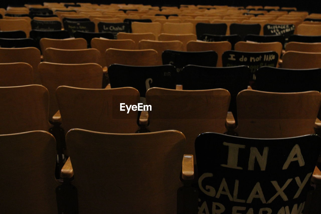 in a row, seat, empty, indoors, chair, theater, absence, arts culture and entertainment, no people, large group of objects, auditorium, day