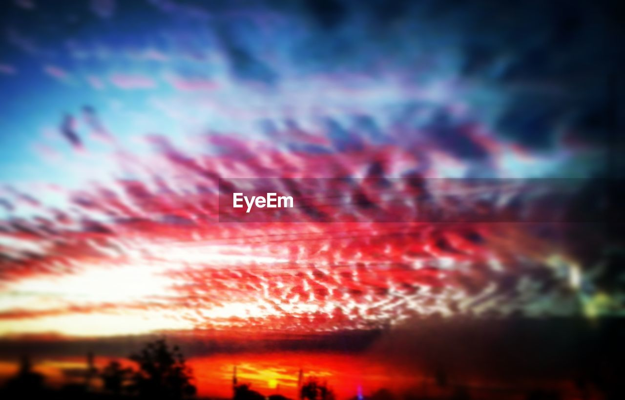 sky, cloud - sky, beauty in nature, no people, sunset, nature, orange color, night, red, low angle view, scenics - nature, illuminated, outdoors, tranquility, backgrounds, dramatic sky, long exposure, multi colored, silhouette, motion