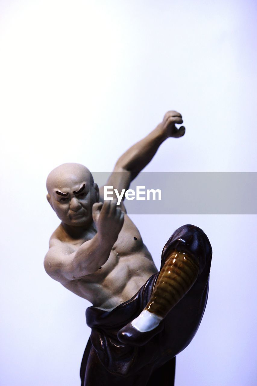 studio shot, representation, art and craft, indoors, sculpture, human representation, people, creativity, human body part, white background, hand, male likeness, gesturing, statue, human hand, copy space, body part, men, finger