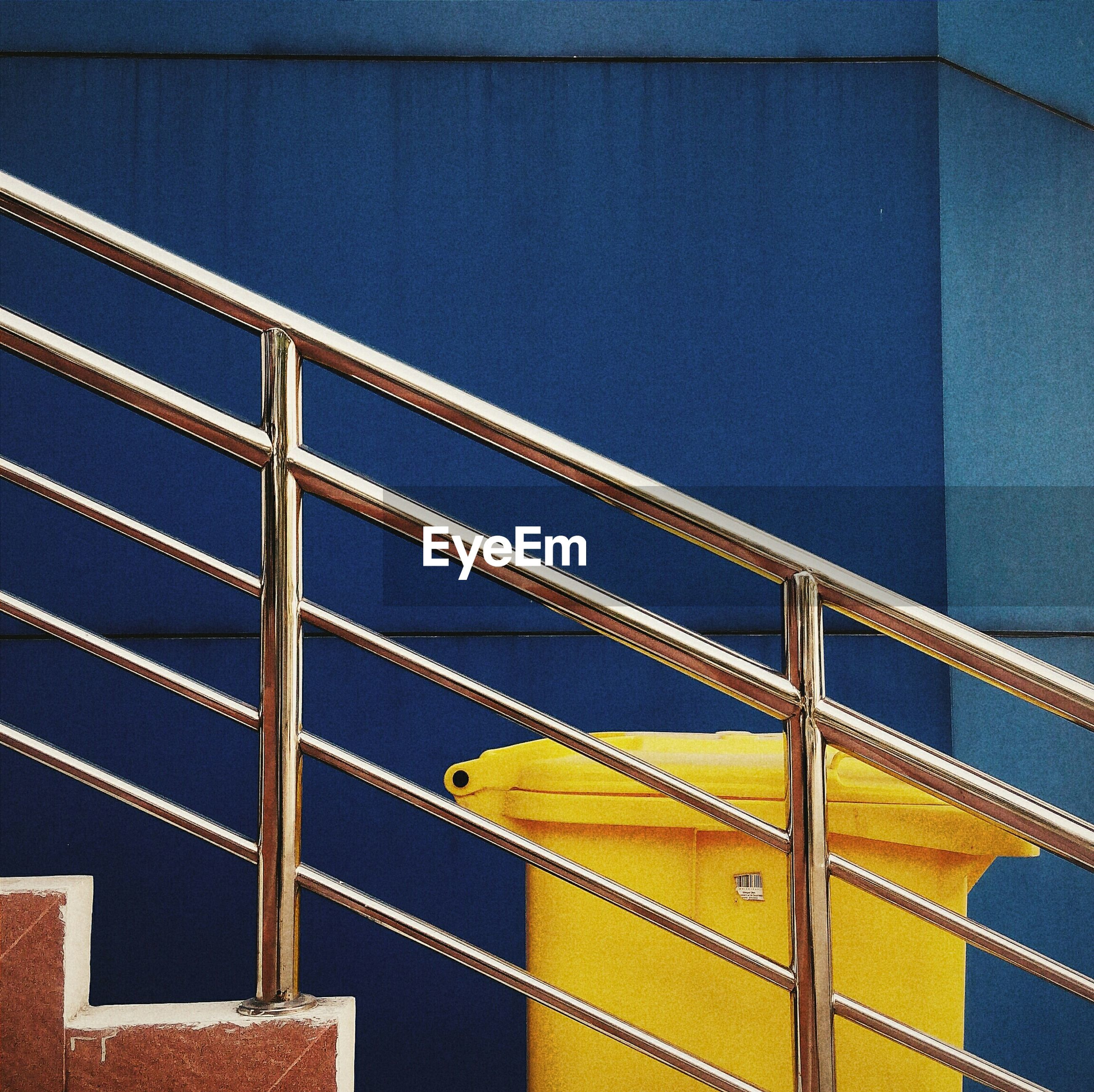architecture, built structure, yellow, blue, building exterior, low angle view, pattern, wall - building feature, railing, metal, full frame, building, no people, wall, indoors, backgrounds, safety, day, repetition