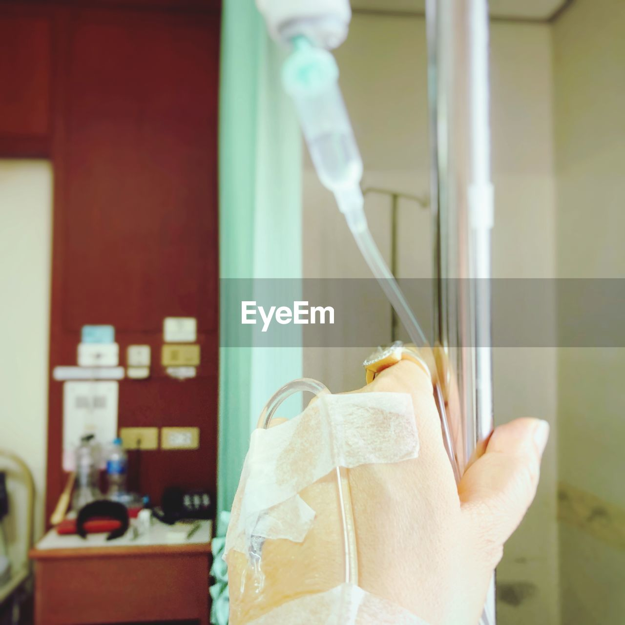 Cropped Hand With Medical Supplies In Hospital
