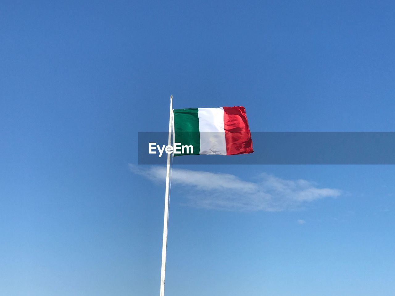 flag, sky, patriotism, low angle view, copy space, blue, pole, nature, day, no people, environment, red, wind, waving, emotion, cloud - sky, pride, outdoors, independence, national icon