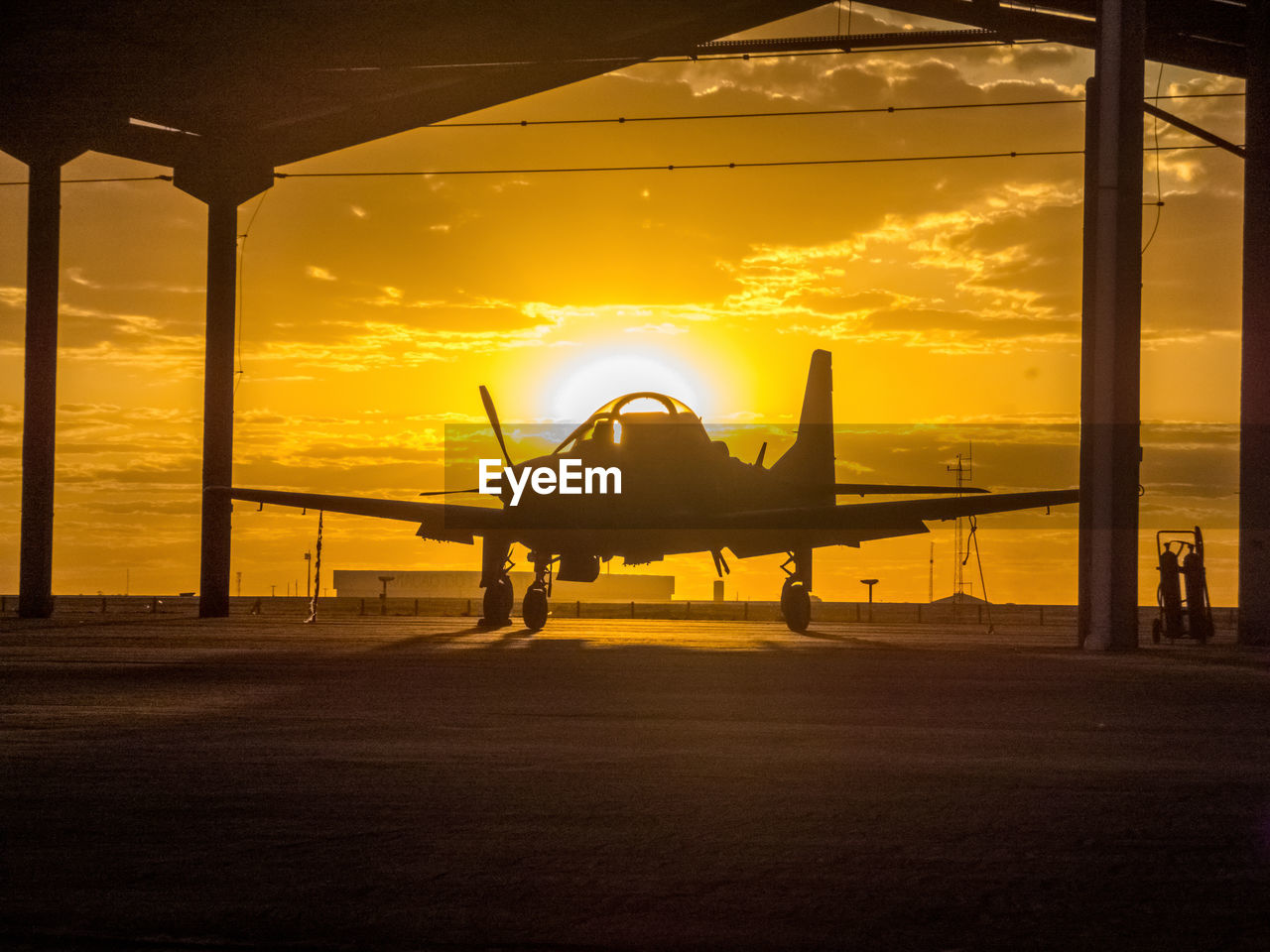 sky, sunset, transportation, cloud - sky, mode of transportation, air vehicle, orange color, nature, airplane, airport, sunlight, airport runway, sun, outdoors, no people, silhouette, journey, travel, aerospace industry, runway