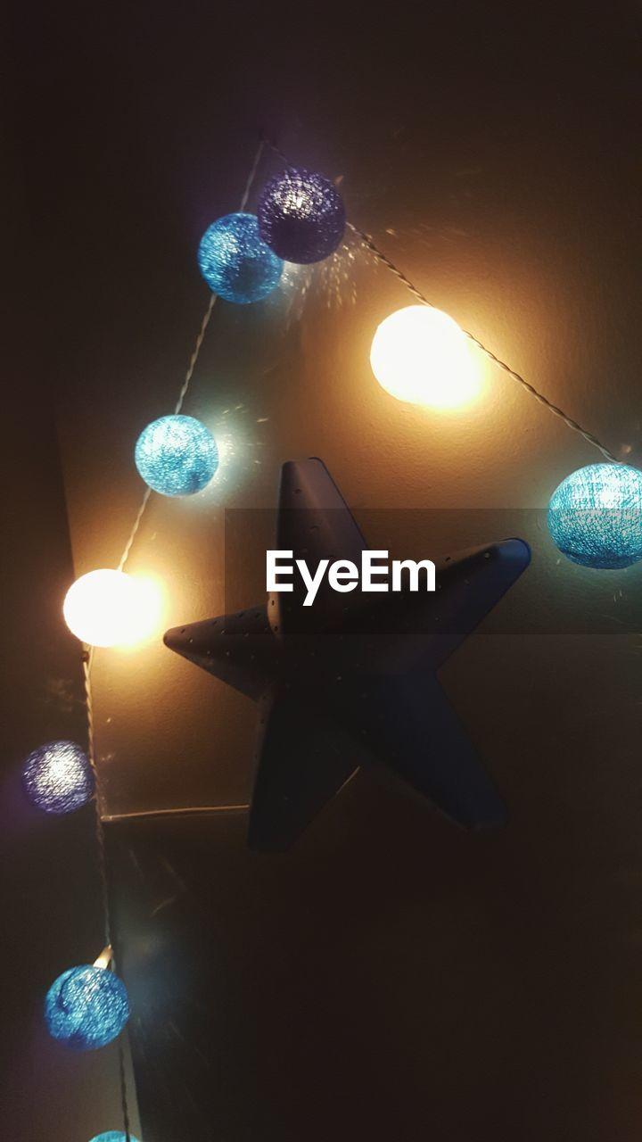 illuminated, lighting equipment, glowing, celebration, flame, burning, christmas decoration, no people, heat - temperature, night, electricity, close-up, studio shot, indoors