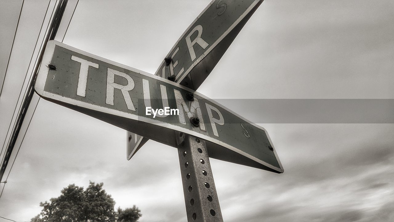 communication, low angle view, sky, sign, text, western script, cloud - sky, no people, information, nature, guidance, road sign, day, information sign, metal, direction, road, directional sign, symbol, outdoors