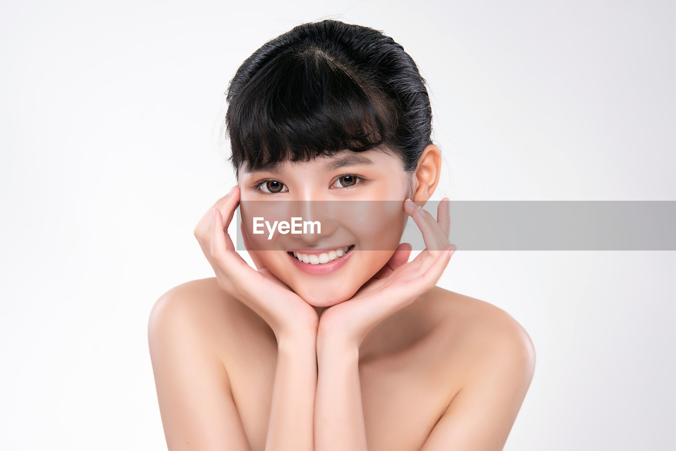 Close-up of young woman over white background