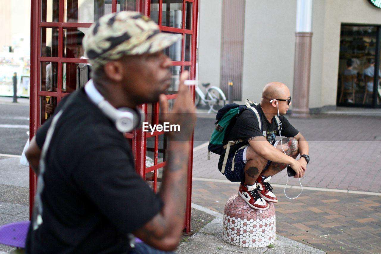 Men At Footpath In City
