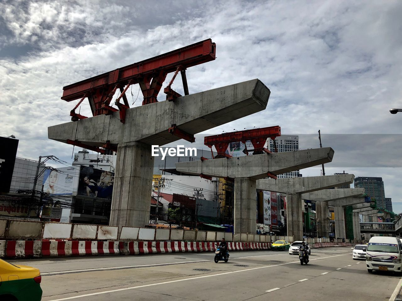 transportation, sky, built structure, architecture, motor vehicle, cloud - sky, mode of transportation, car, road, city, building exterior, land vehicle, nature, bridge, street, incidental people, bridge - man made structure, connection, day, outdoors, architectural column