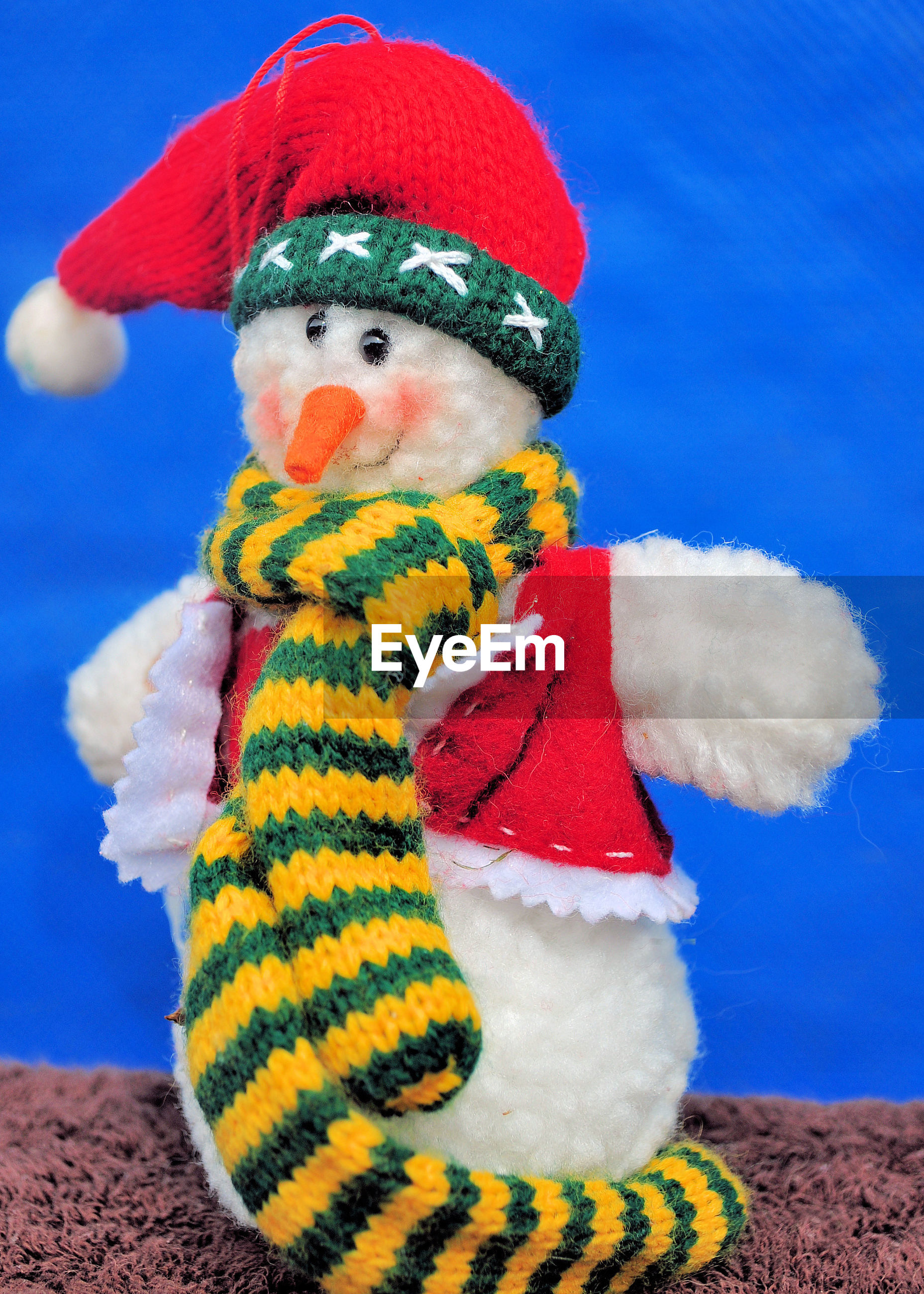 Close-up of stuffed snowman toy on table