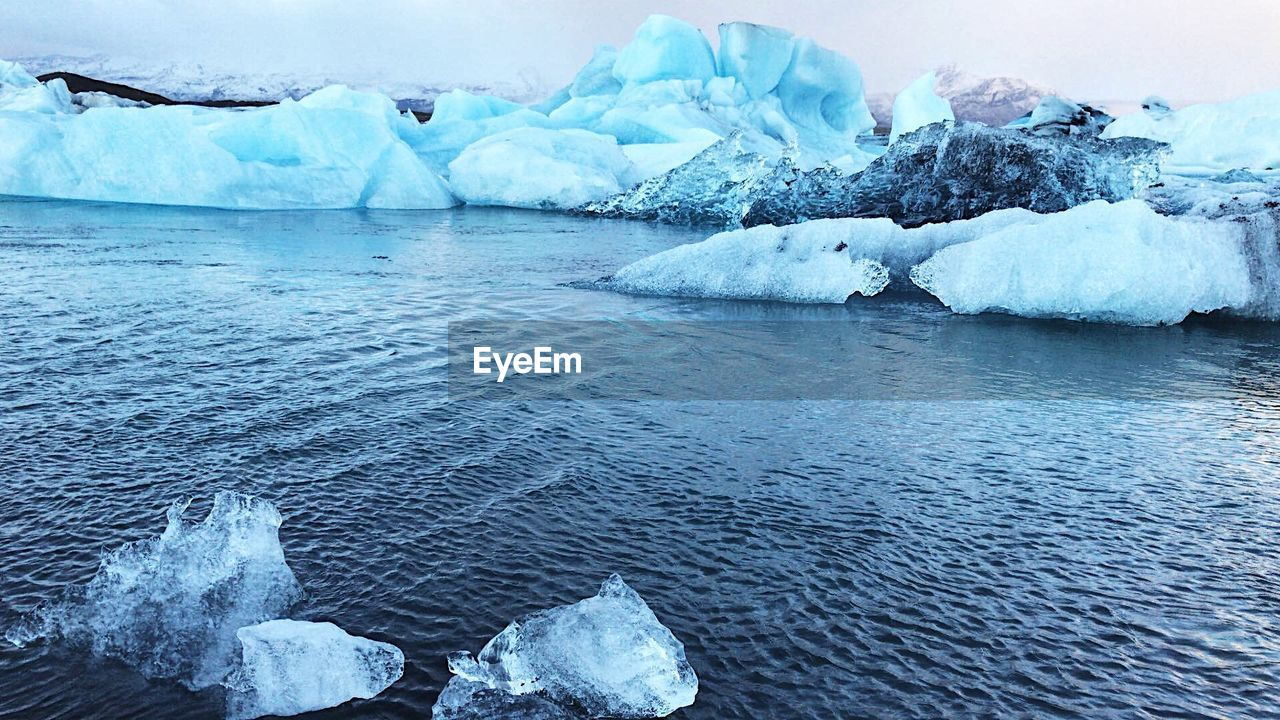 water, ice, cold temperature, frozen, glacier, scenics - nature, winter, beauty in nature, sea, tranquility, tranquil scene, environment, day, nature, snow, iceberg, landscape, iceberg - ice formation, no people, outdoors, floating on water, melting, lagoon, turquoise colored