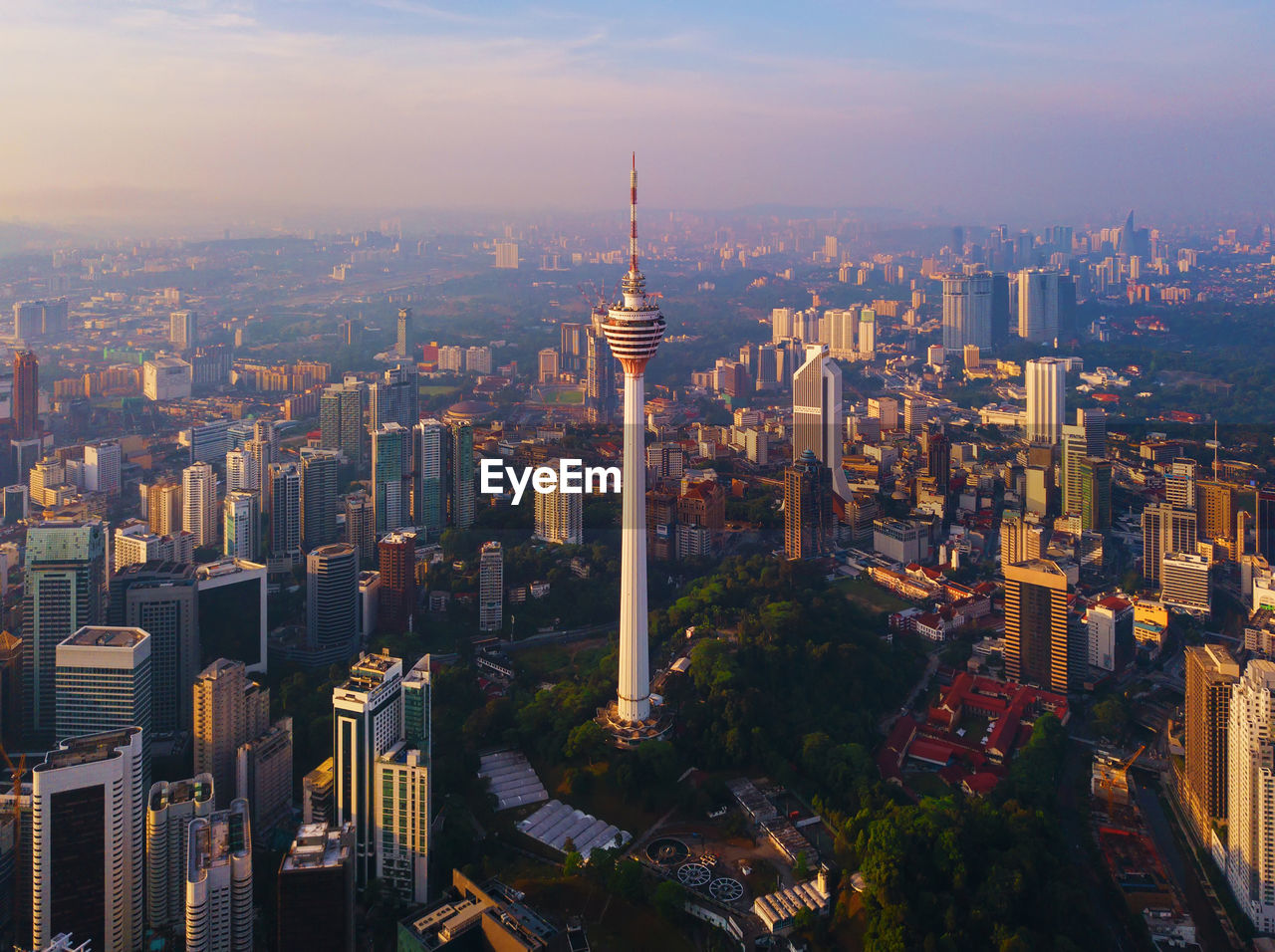 building exterior, architecture, city, built structure, cityscape, building, sky, crowd, office building exterior, tall - high, skyscraper, modern, tower, travel destinations, nature, crowded, high angle view, residential district, outdoors, financial district, spire, apartment