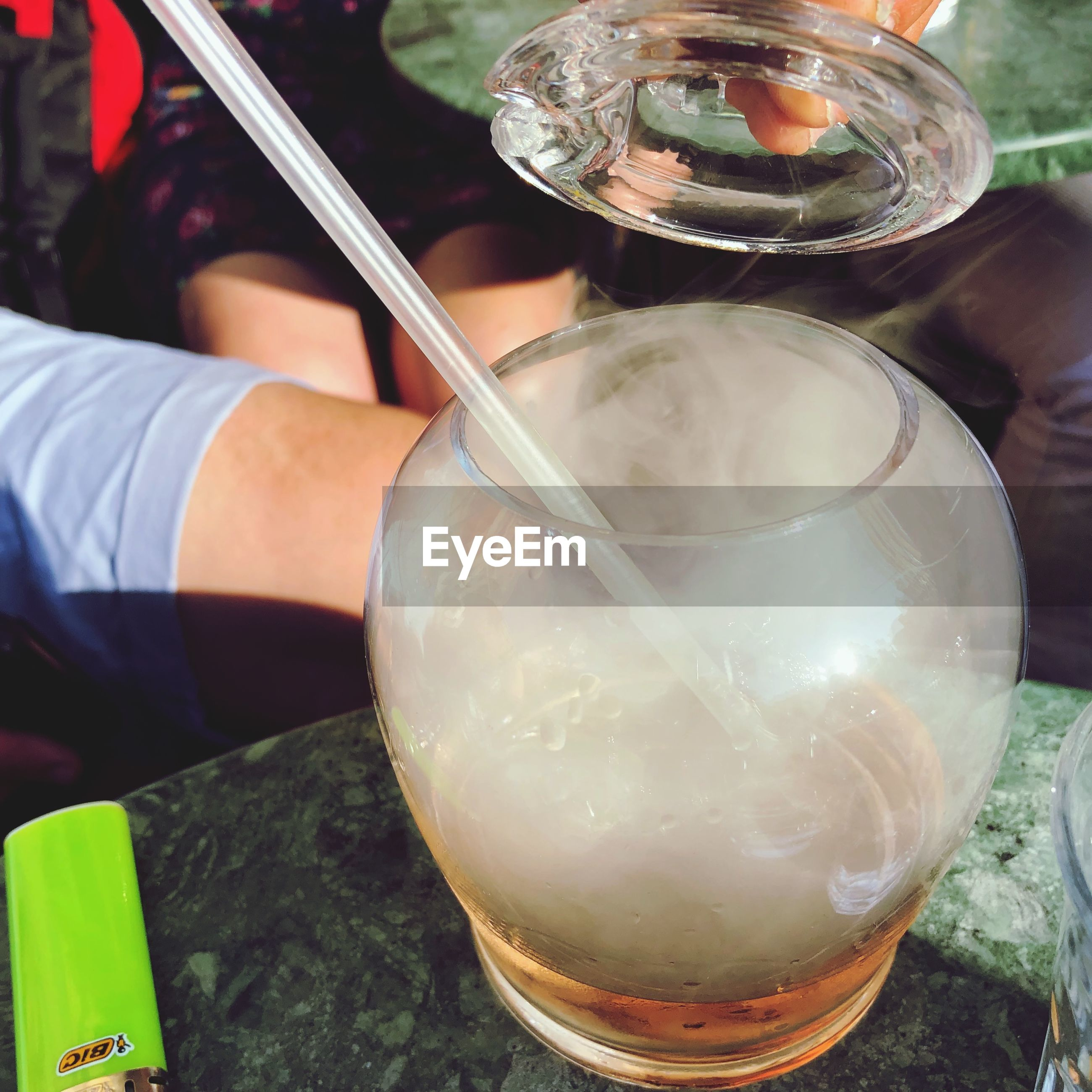 drink, glass, food and drink, refreshment, household equipment, drinking glass, close-up, hand, real people, one person, holding, human hand, glass - material, transparent, table, human body part, freshness, indoors, food