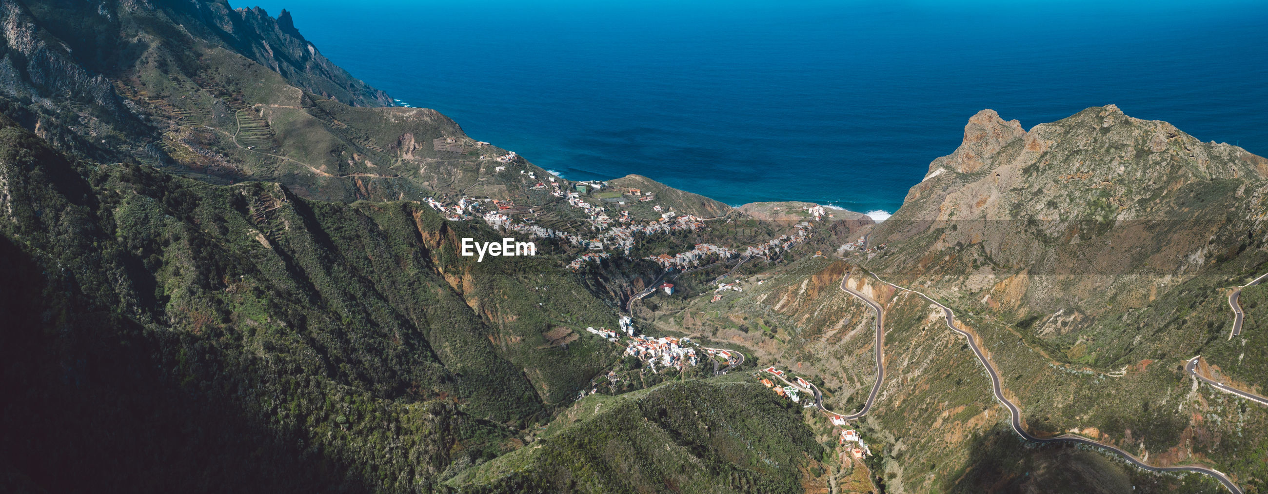 High angle view of panoramic shot of sea and mountains
