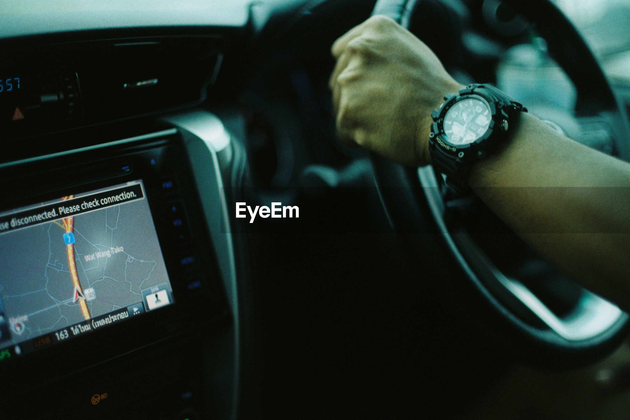 human hand, hand, human body part, time, watch, car, mode of transportation, wristwatch, transportation, motor vehicle, car interior, one person, vehicle interior, real people, body part, land vehicle, indoors, lifestyles, travel, finger