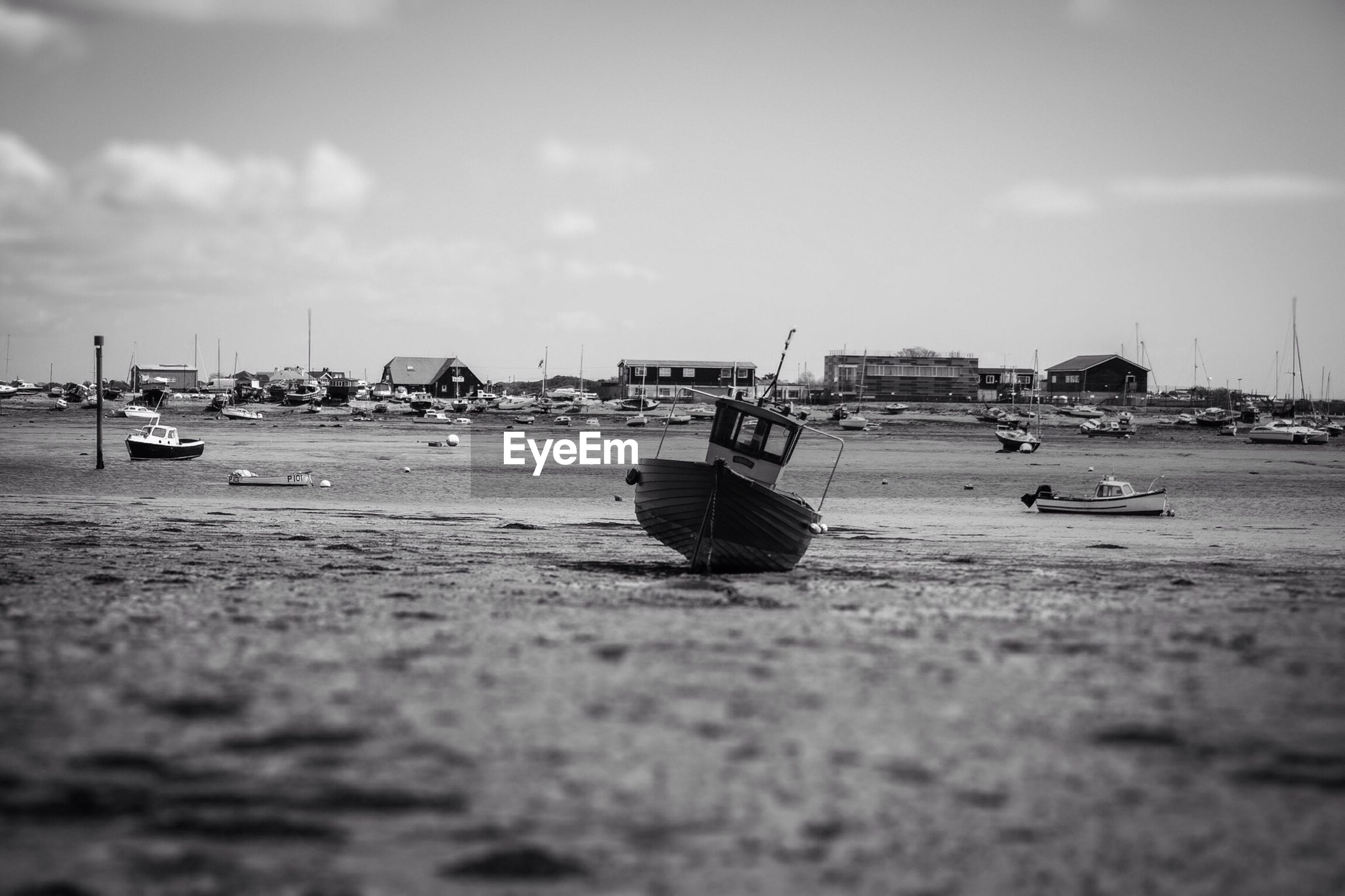View of boats on shore against the sky