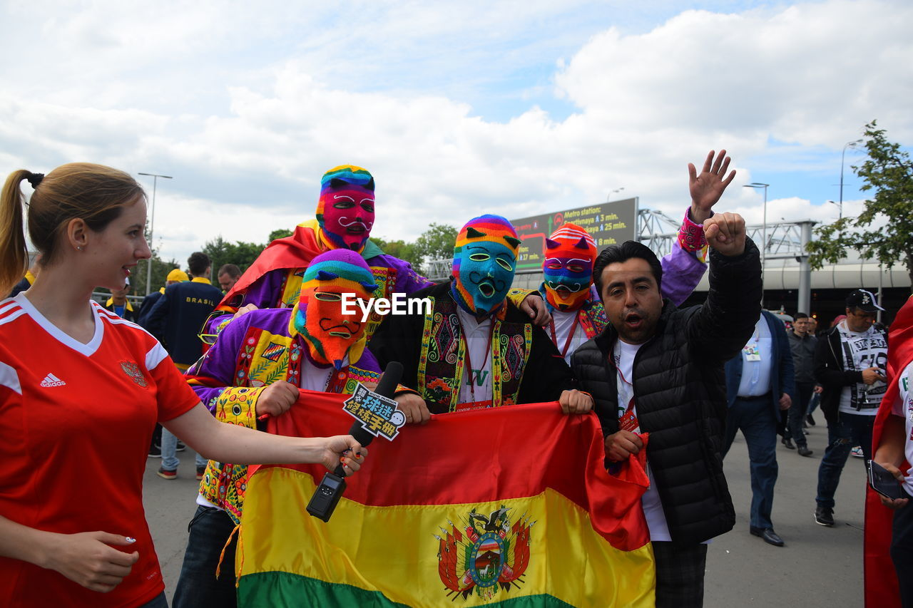 group of people, real people, day, celebration, people, costume, cloud - sky, adult, sky, crowd, lifestyles, men, arts culture and entertainment, enjoyment, festival, outdoors, performance, women, standing, carnival - celebration event