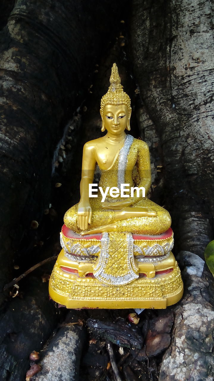 belief, male likeness, religion, spirituality, sculpture, representation, place of worship, statue, building, art and craft, architecture, human representation, no people, built structure, gold colored, creativity, day, outdoors, idol, ornate