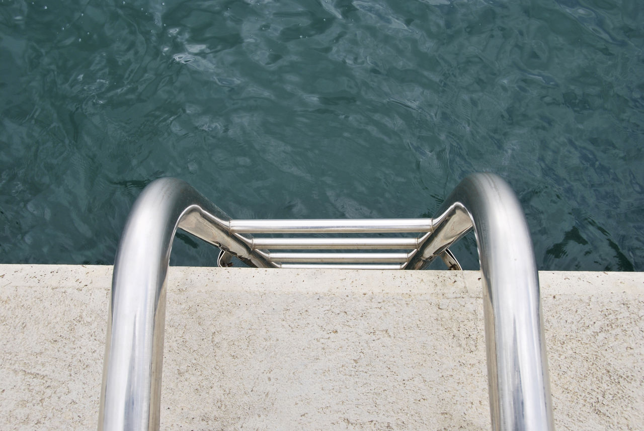 High angle view of ladder in sea