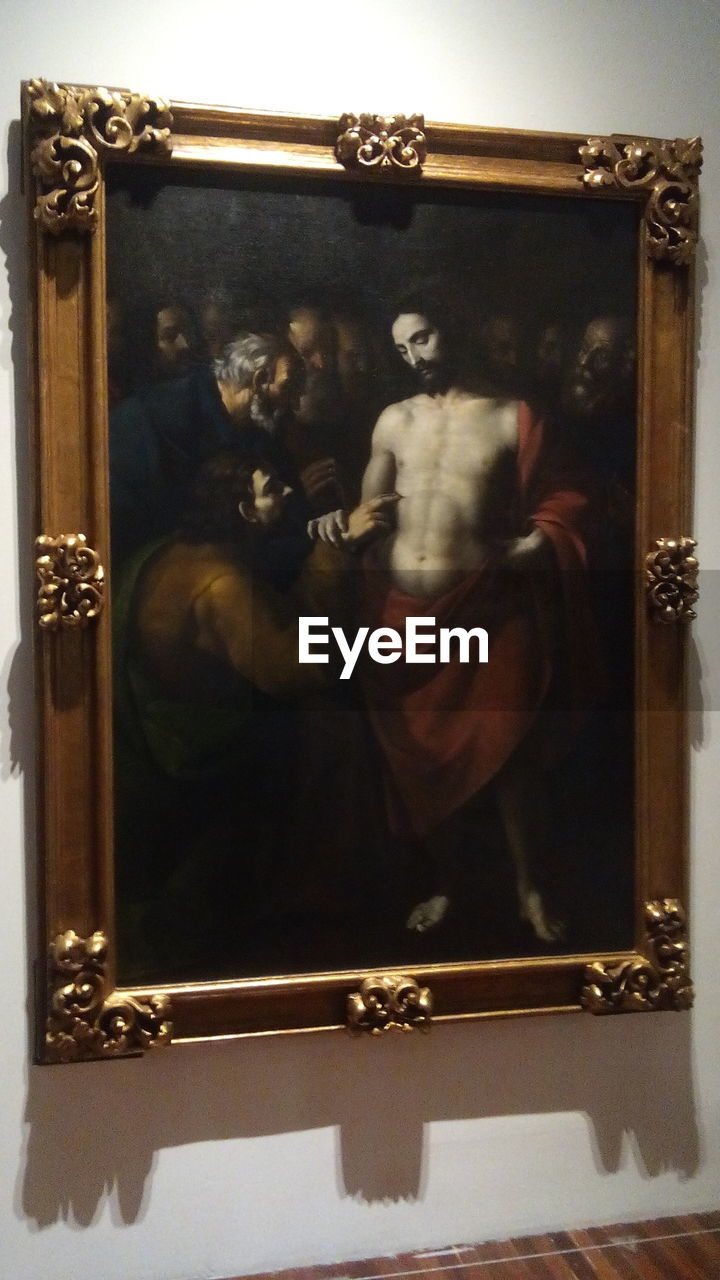 indoors, mirror, representation, human representation, men, frame, people, arts culture and entertainment, art and craft, real people, male likeness, creativity, lifestyles, sculpture, reflection, picture frame, performance, adult, music