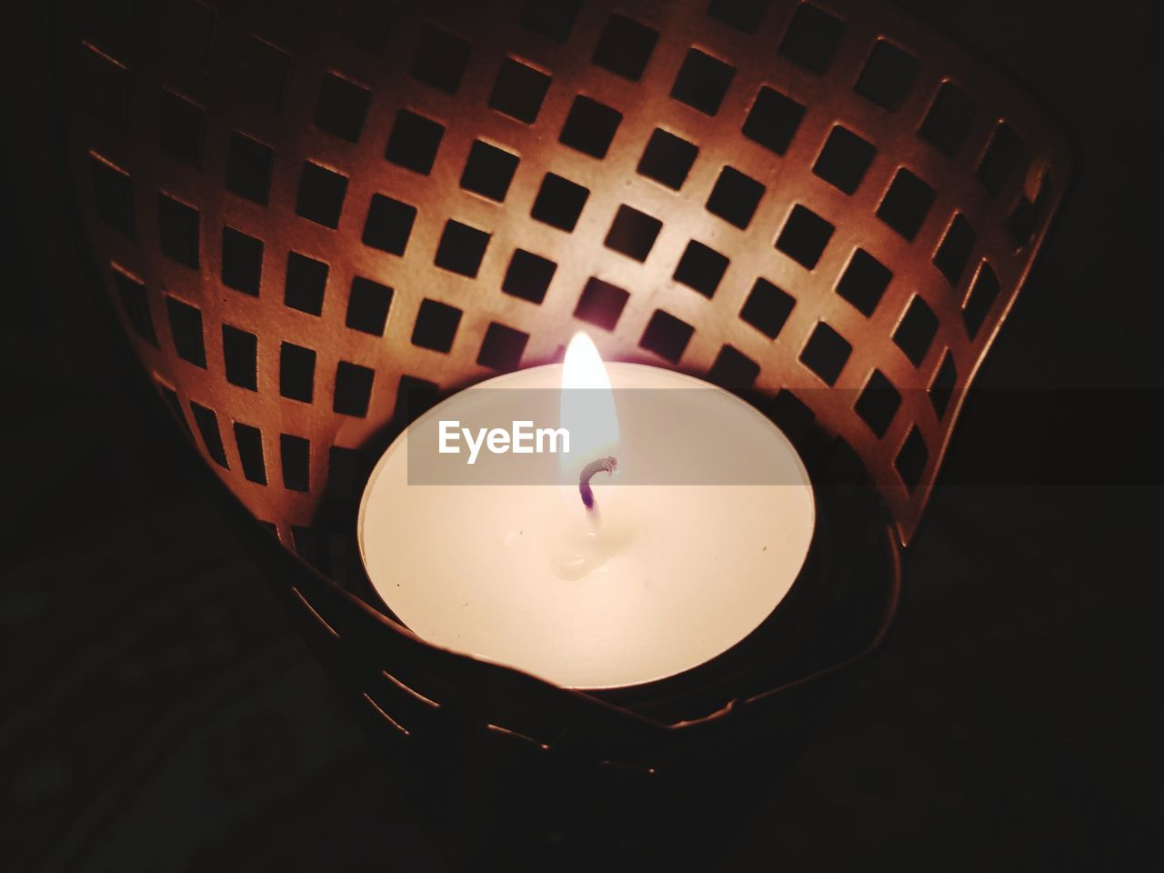 flame, candle, burning, heat - temperature, illuminated, glowing, tea light, lighting equipment, high angle view, close-up, indoors, no people, black background