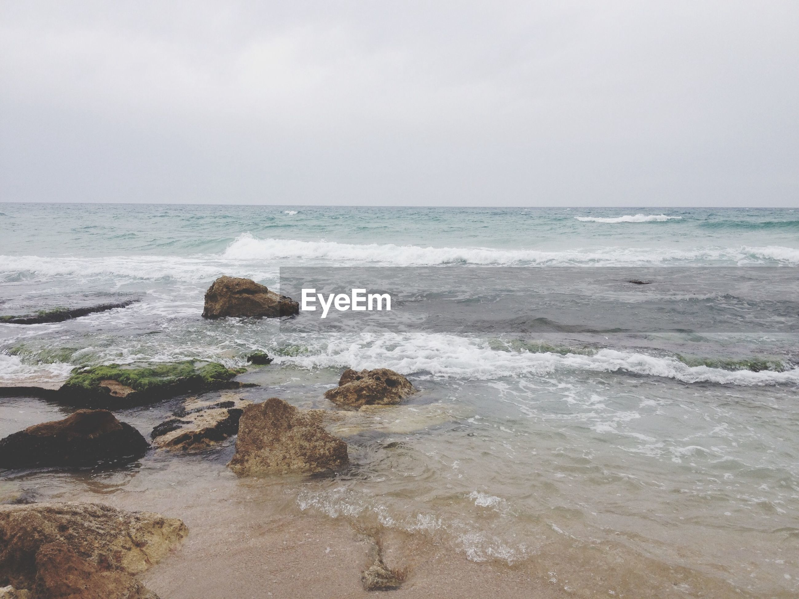 sea, horizon over water, water, beach, scenics, wave, beauty in nature, tranquil scene, shore, tranquility, sky, nature, surf, idyllic, rock - object, remote, sand, seascape, coastline, outdoors