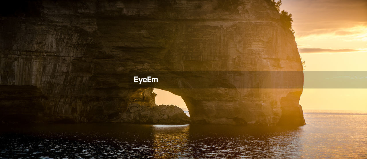 rock formation, arch, natural arch, rock - object, beauty in nature, nature, waterfront, scenics, water, tranquility, no people, cliff, sea, travel destinations, cave, outdoors, sunset, day, sky