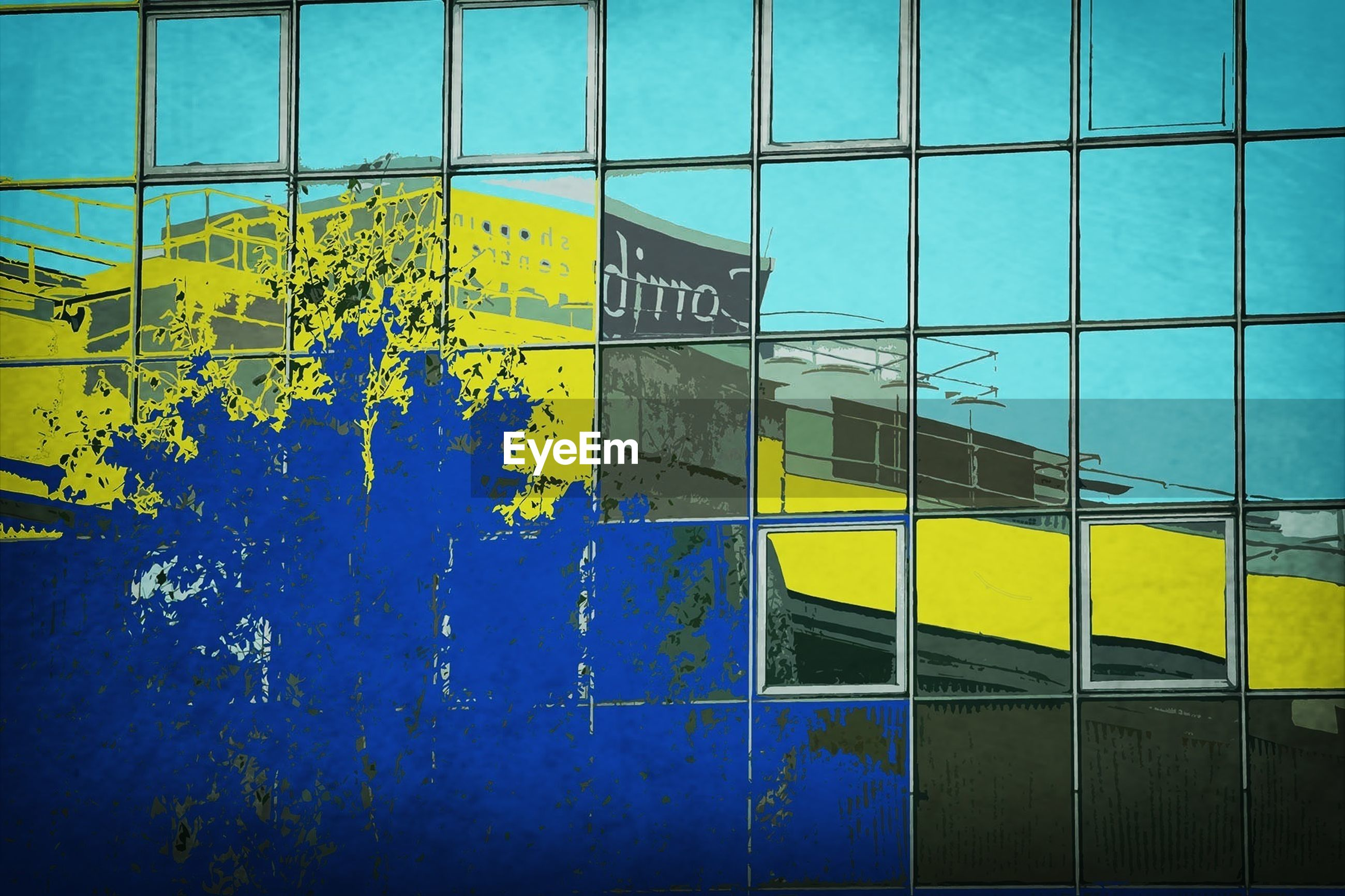 architecture, built structure, building exterior, yellow, blue, window, glass - material, building, wall - building feature, low angle view, modern, city, day, multi colored, sky, pattern, no people, wall, reflection, outdoors