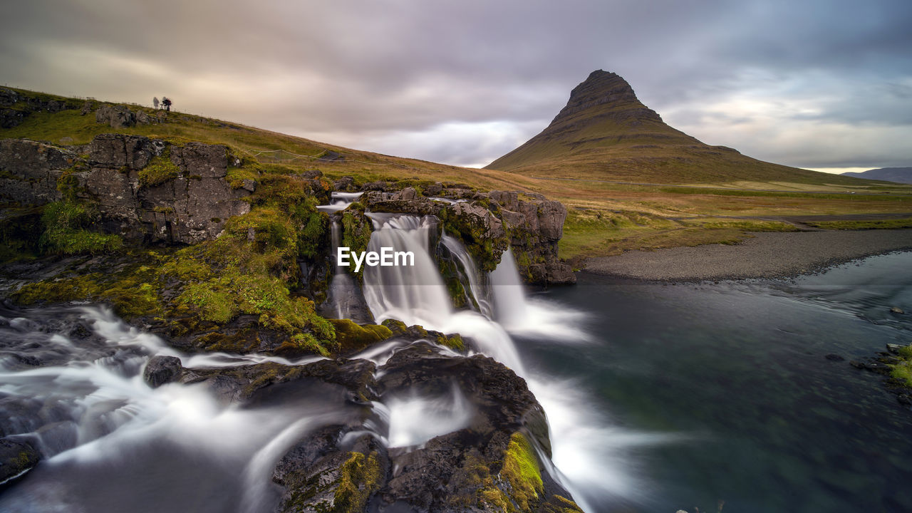 VIEW OF WATERFALL AGAINST SKY