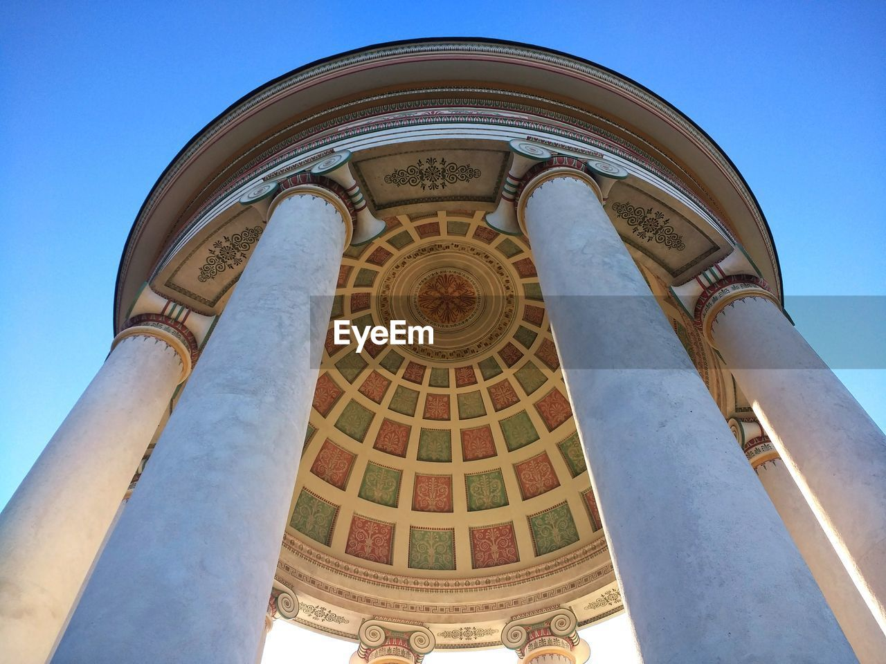 low angle view, architecture, built structure, sky, building exterior, blue, no people, building, arch, day, dome, travel destinations, nature, clear sky, religion, history, the past, architectural column, place of worship, belief, cupola