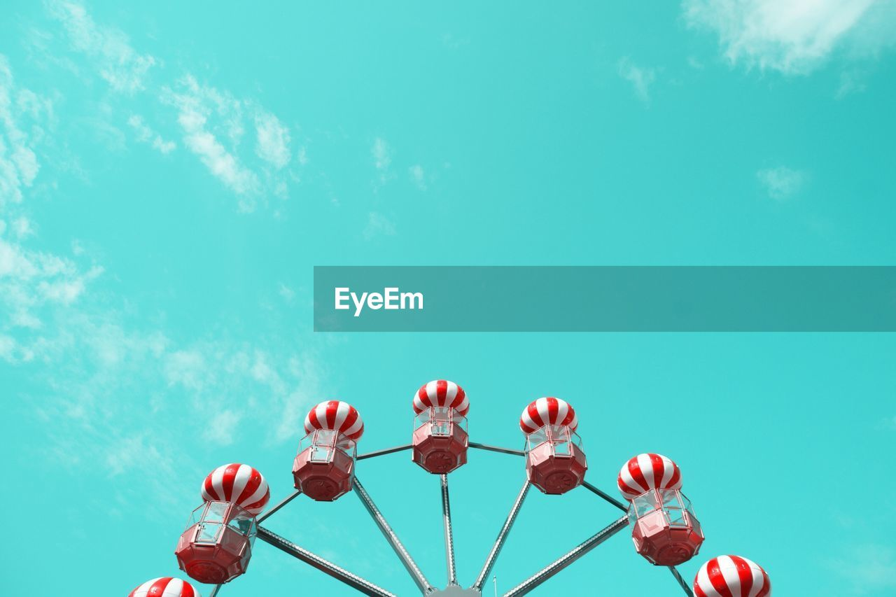 Low Angle View Of Red Striped Ferris Wheel Against Sky