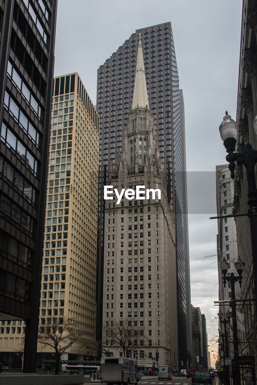 architecture, building exterior, skyscraper, tall - high, built structure, tower, modern, city, low angle view, sky, day, tall, outdoors, no people, travel destinations, cityscape