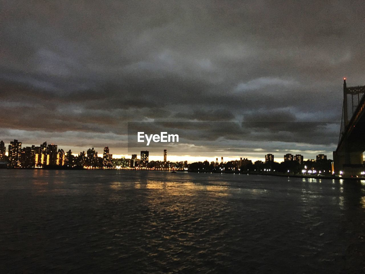 architecture, building exterior, built structure, sky, city, cloud - sky, water, waterfront, river, no people, cityscape, outdoors, city life, sunset, travel destinations, silhouette, nature, skyscraper, urban skyline, storm cloud, tree, day