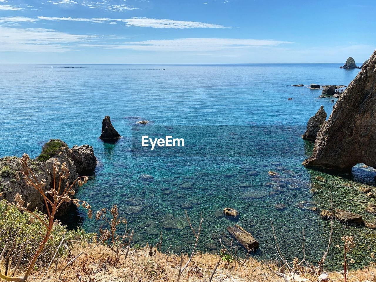 sea, water, scenics - nature, beauty in nature, horizon, sky, horizon over water, tranquility, tranquil scene, idyllic, nature, day, blue, rock, land, non-urban scene, cloud - sky, no people, rock - object, outdoors