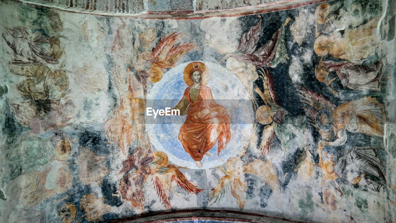 art and craft, close-up, history, no people, indoors, creativity, mural, architecture, the past, representation, human representation, craft, paint, fresco, paintings, day, wall - building feature, religion, ancient, textured effect, concentric