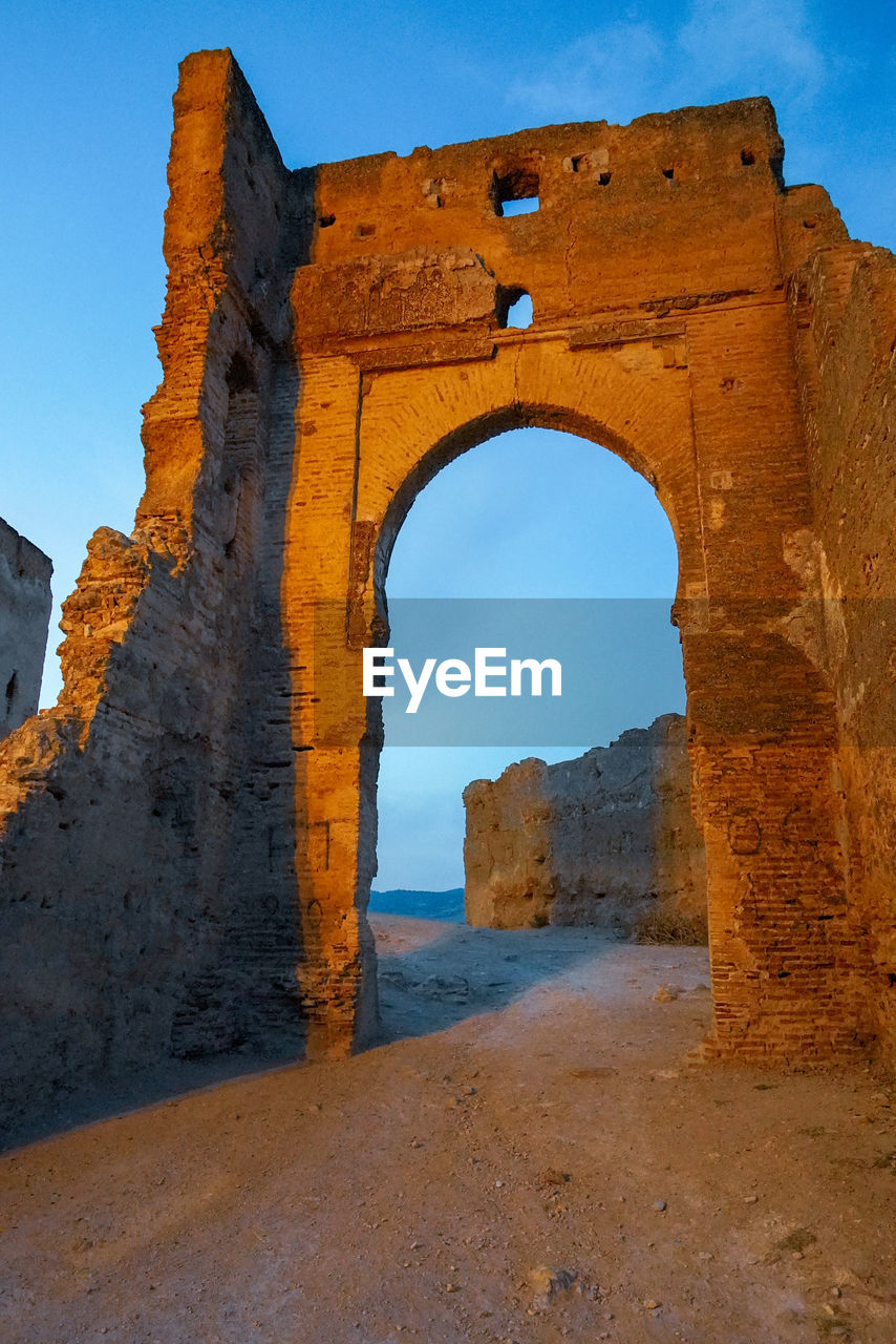 arch, architecture, sky, history, built structure, the past, no people, nature, day, solid, natural arch, clear sky, rock - object, rock, travel destinations, old ruin, water, old, rock formation, outdoors, ruined, ancient civilization
