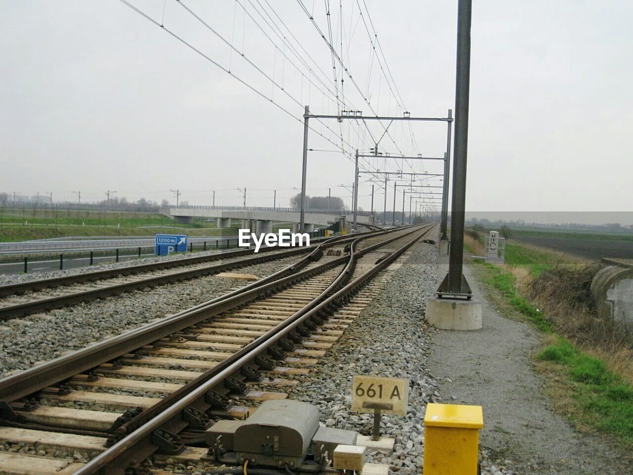 railroad track, rail transportation, transportation, connection, cable, no people, day, outdoors, electricity pylon, sky, the way forward, electricity, technology, grass, nature