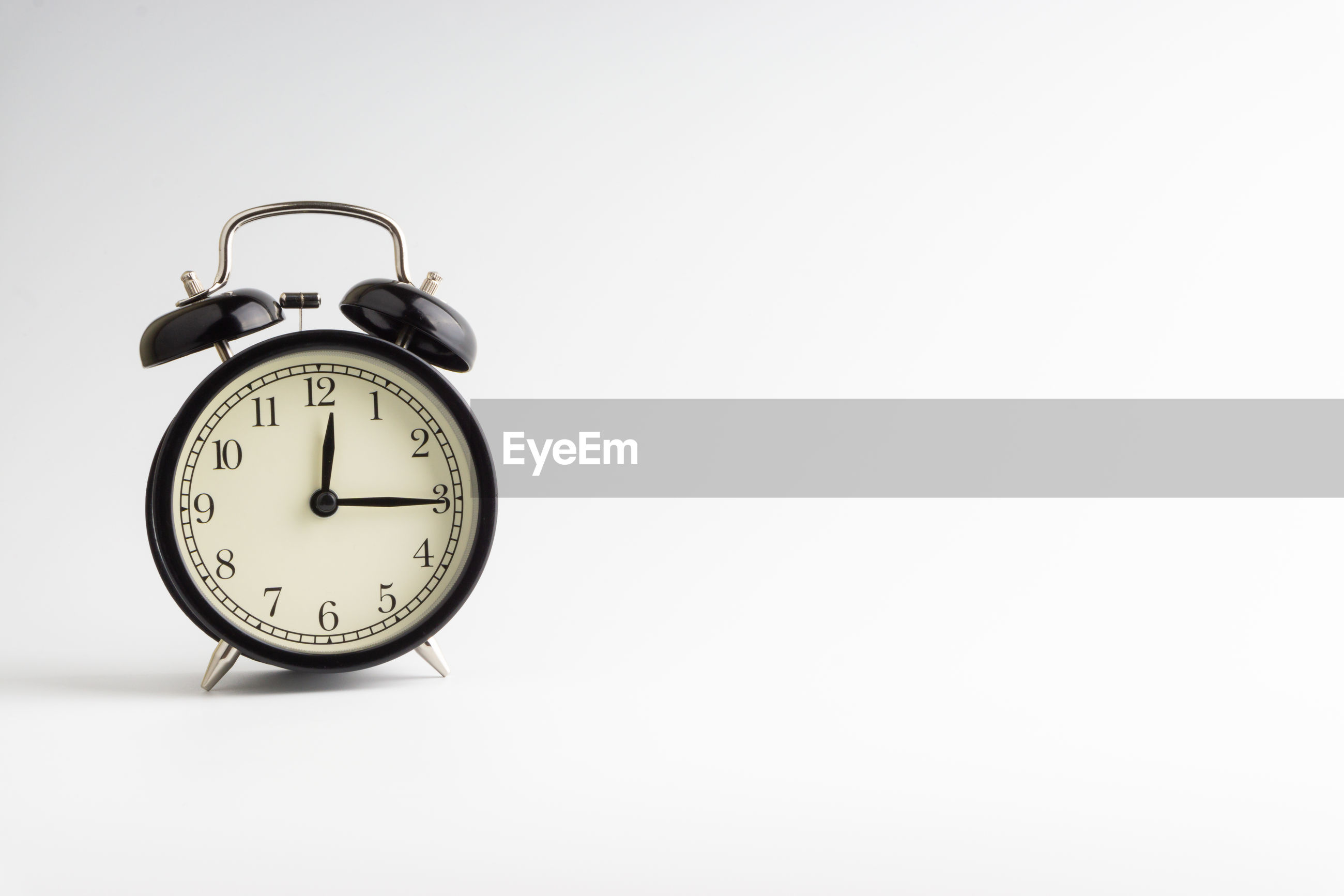 Close-up of alarm clock over white background