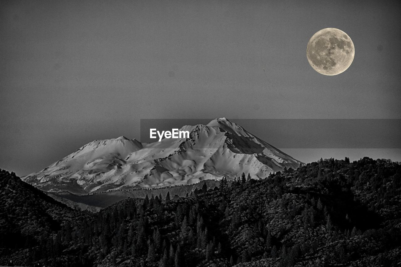 moon, mountain, sky, scenics - nature, beauty in nature, astronomy, tranquil scene, full moon, night, tranquility, space, no people, non-urban scene, nature, cold temperature, environment, planetary moon, mountain range, outdoors, winter, snowcapped mountain, moonlight, mountain peak, formation