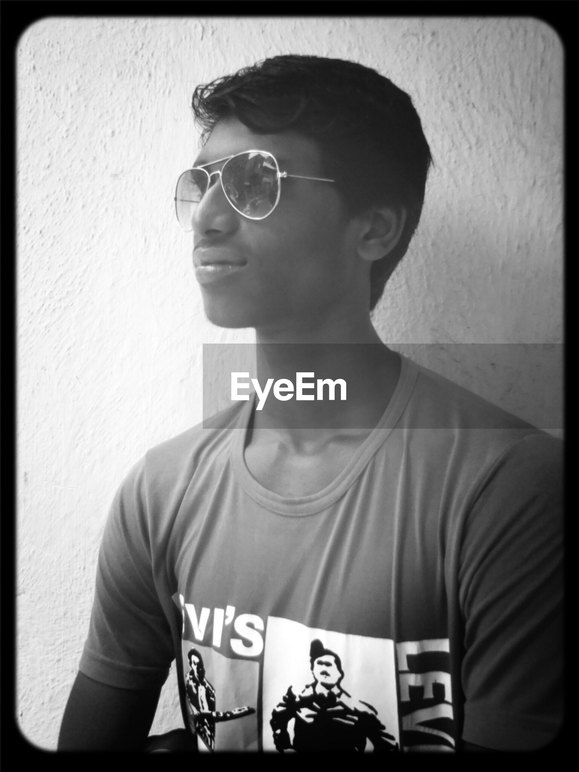 lifestyles, transfer print, young adult, auto post production filter, indoors, front view, young men, casual clothing, person, leisure activity, looking at camera, portrait, headshot, mid adult, men, sunglasses, mid adult men, standing