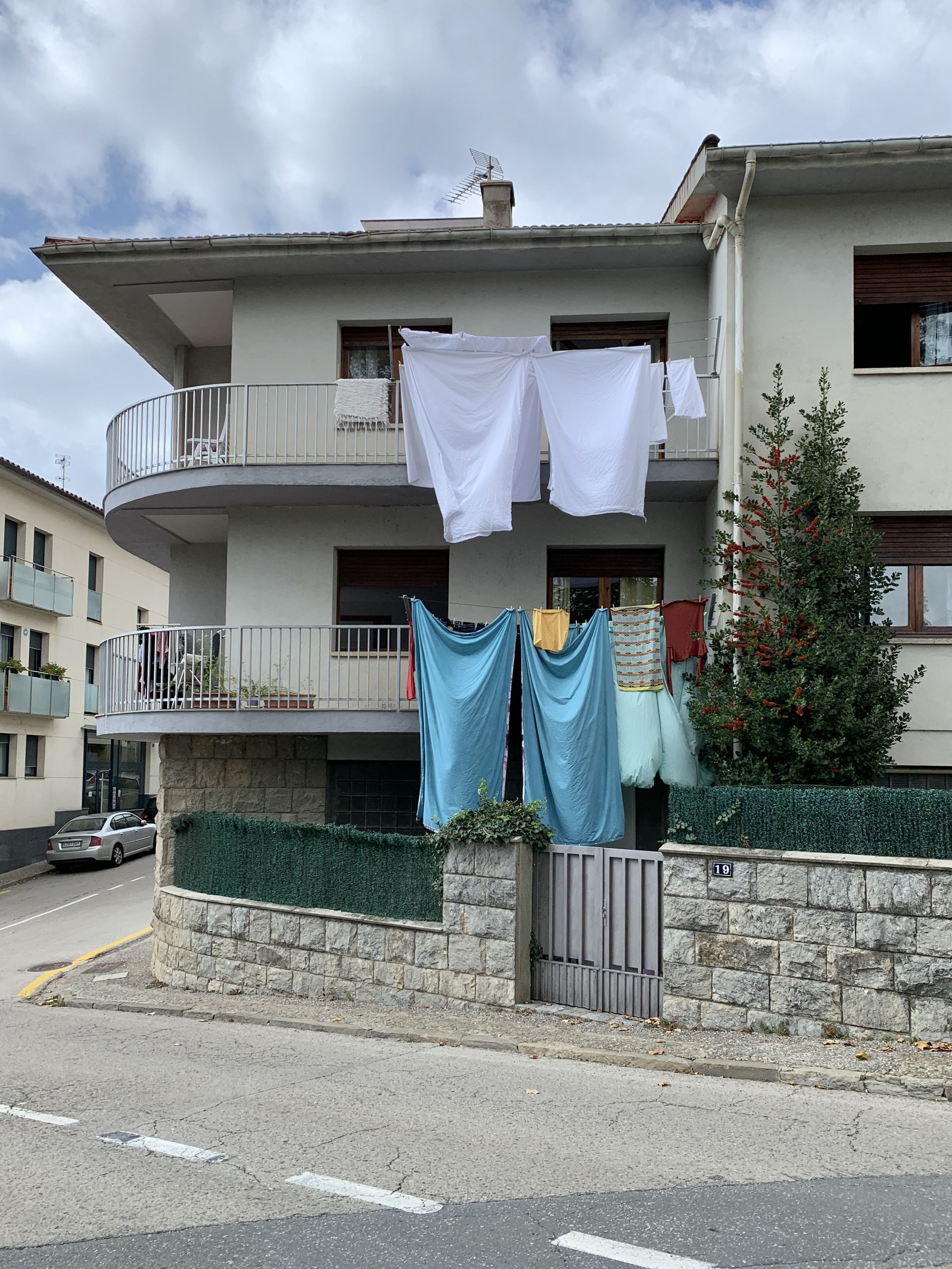 CLOTHES DRYING ON FOOTPATH AGAINST BUILDING