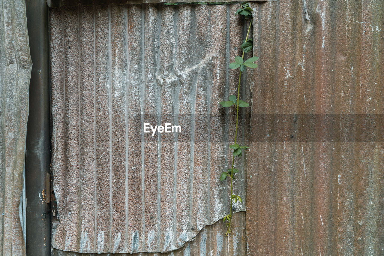 Full frame shot of weathered metal fence