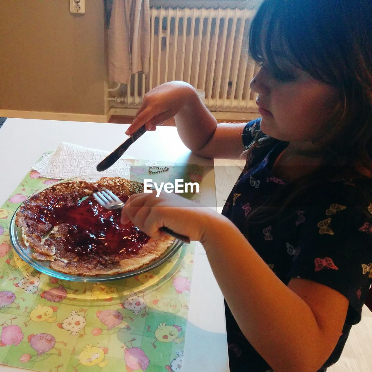 food and drink, food, child, childhood, girls, one person, women, indoors, lifestyles, real people, kitchen utensil, eating utensil, females, holding, table, spoon, freshness, sweet food, innocence, breakfast